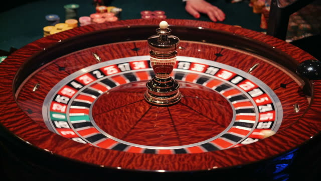 The small ball falls into the slot as the Roulette Wheel spins video
