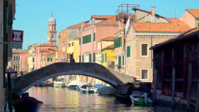 The small bridge in the middle of the canal in Venice Italy video