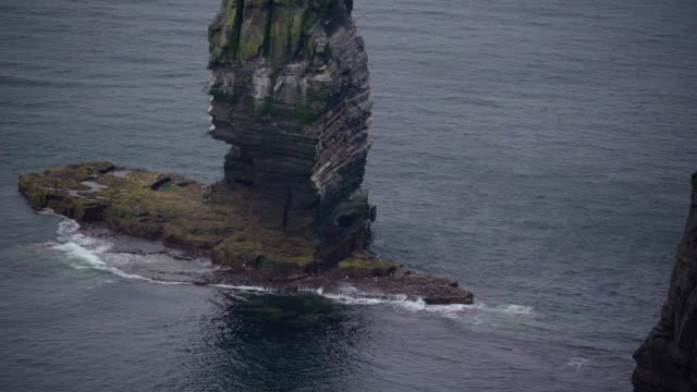 The small rock formation in the middle of the sea Ireland video