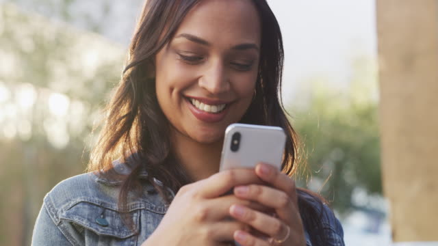The smile on her face tells you how sweet that text is video
