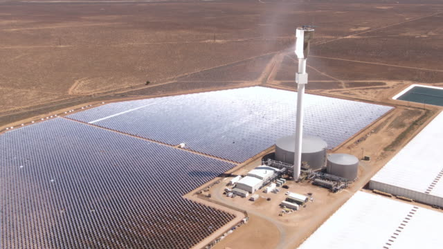 The solar thermal power plant which uses mirrors to heat salt in the tower. Molten salt is used to generate steam power. Green energy and global warming concept.