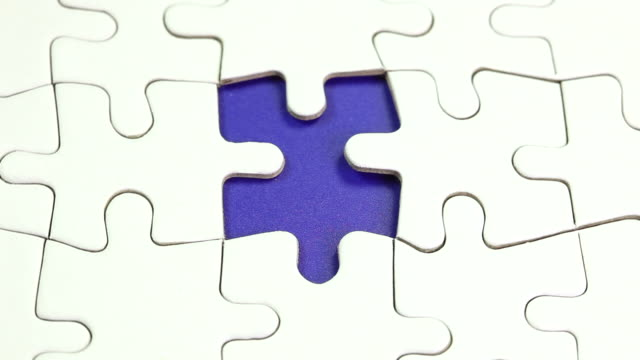 The solution - Hand places piece into puzzle video
