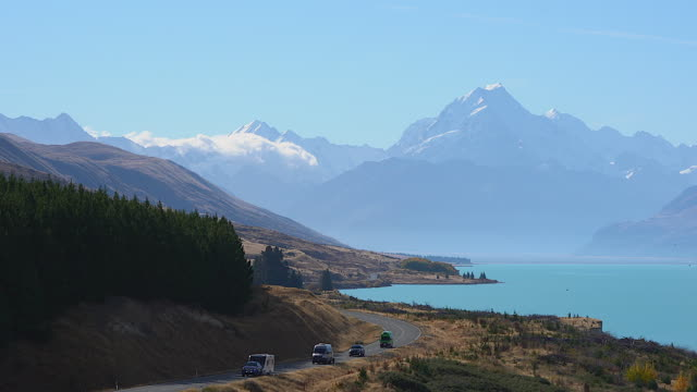 The Southern Alps, Road to Mt Cook, the highest mountain in New Zealand. Scenic highway drive along Lake Pukaki in Aoraki Mt Cook National Park, South Island of New Zealand.