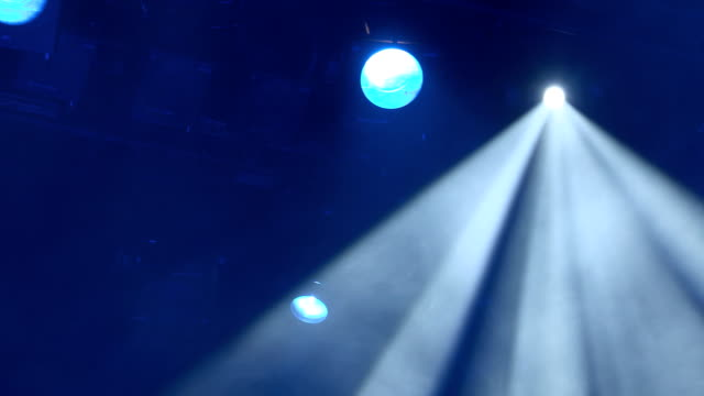 The spotlight through the smoke on stage. Lighting equipment. Effect Lights. Scanner. Color Changers. Moving Yoke. Moving Head video
