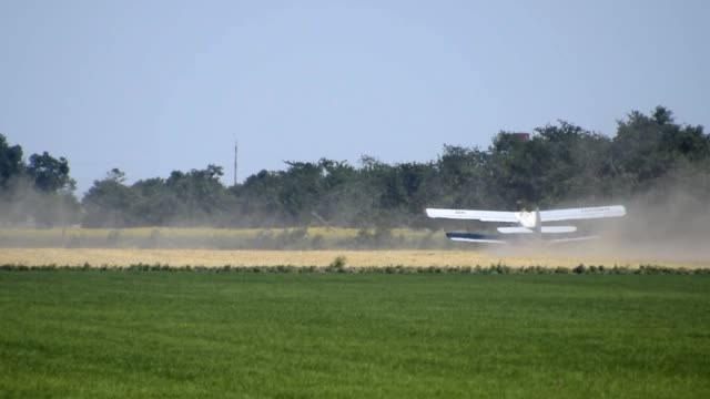 The spraying of fertilizers and pesticides on the field with the aircraft. video