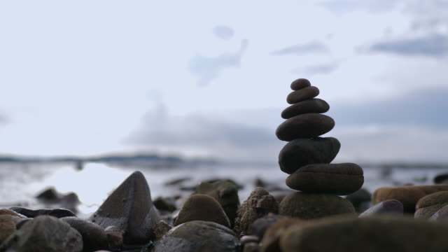 The stack of rock for healthy balance and aroma concept on the natural beach select focus shallow depth of field
