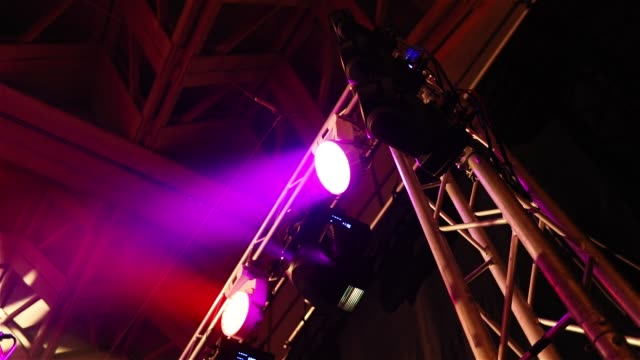 The stage lighting in the hall, the stage light on the counter, metal stand for stage light, the view from below video