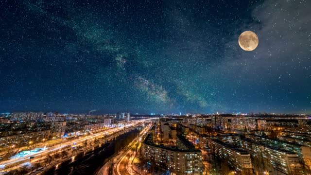 the starry sky with a moon above the beautiful city. time lapse - lanterna attrezzatura per illuminazione video stock e b–roll