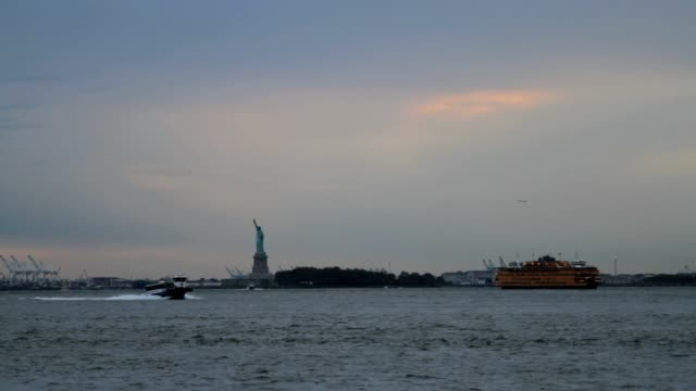 The Statue of Liberty and Ellis Island at dusk video