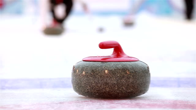 Video The stones for Curling on the ice.