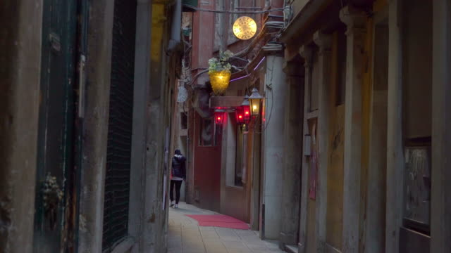 The streetlamps on the side of the buildings in Venice Italy video