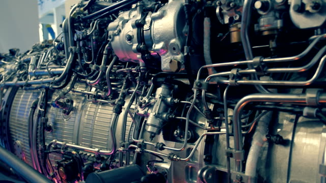 The structure of the aircraft engine The structure of the aircraft engine. There are lots of pipes, pumps, compressors, gears, pulleys, blades, valves, hydraulic and servo drives and other elements propeller airplane stock videos & royalty-free footage