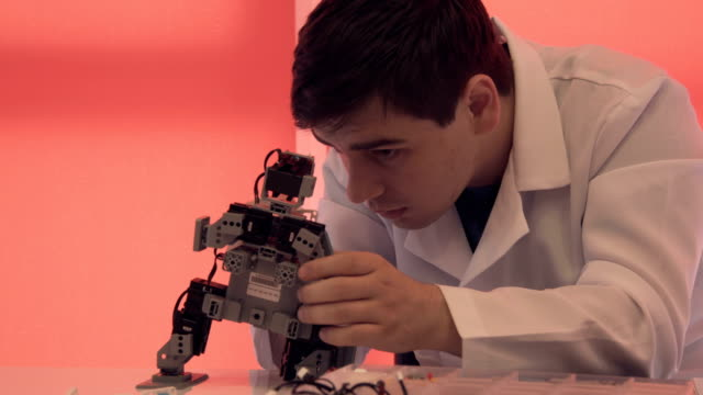 The student creates a robot in the laboratory video