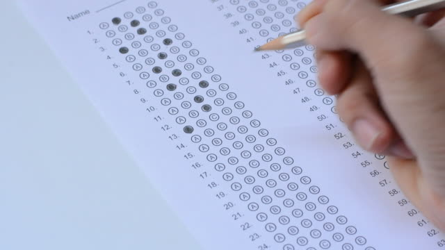 the student fills in answers on the standardized multiple choice test video
