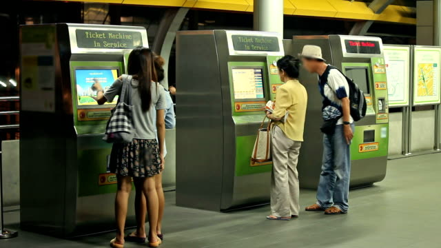 The subway, ticket machine, time lapse of people are waiting. video
