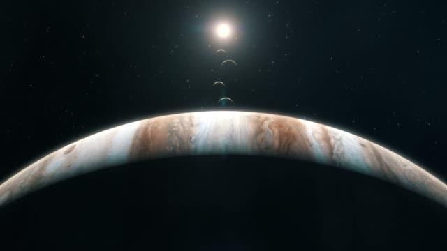 the sun and the moons set behind jupiter - above - io księżyc filmów i materiałów b-roll