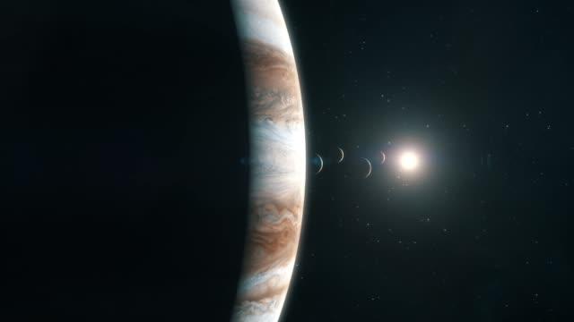 the sun and the moons set behind jupiter - side - io księżyc filmów i materiałów b-roll