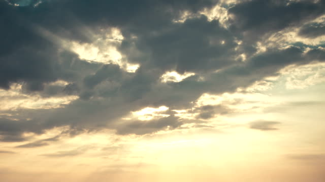The sun breaking through scenic clouds video