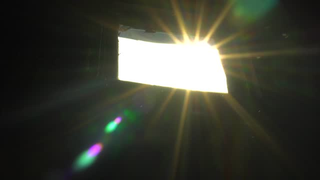 The Sun Breaks Through the Window into the Dark Room, the Sun's Rays The Sun Breaks Through the Window into the Dark Room, the Sun's Rays. brightly lit stock videos & royalty-free footage