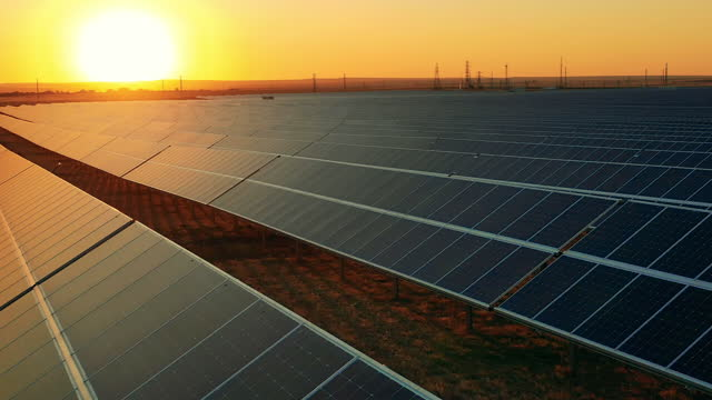 The sun is setting at the photovoltaic power plant video