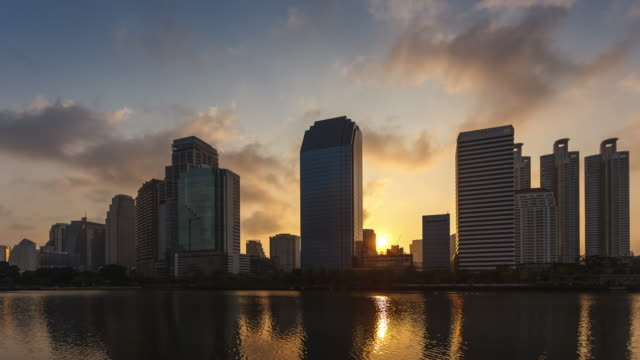 The sun rises behind the buildings in Bangkok. Time-lapse Sun rises behind the buildings in Bangkok. daylight savings stock videos & royalty-free footage