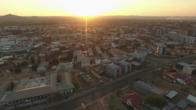 The sun setting over Windhoek Aerial drone footage of the sun setting over Windhoek namibia stock videos & royalty-free footage