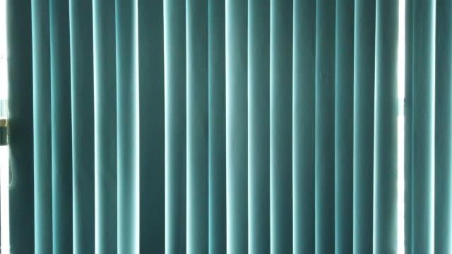 the sun through the closed curtains in office Hanoi ,Vietnam