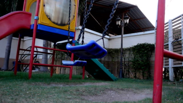 The swing on kid play yard on slow motion footage video