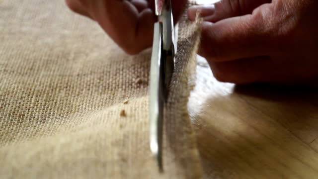 The tailor cut out the fabric. Slow motion The tailor cuts cloth iron scissors. fabric swatch stock videos & royalty-free footage