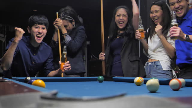The team play the billiards after party in the bar.