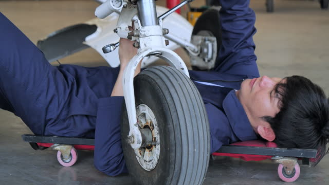 The technician planning and performs the aircraft repair inside the aircraft collector.