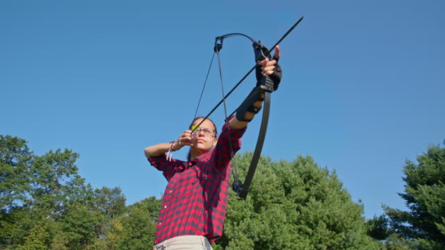 The teenager girl practicing archery video