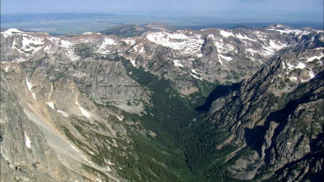 the Teton Range  - Aerial View - Wyoming,  Teton County,  helicopter filming,  aerial video,  cineflex,  establishing shot,  United States video