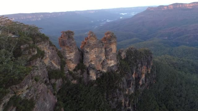 The Three Sisters Flyover The Three Sisters flyover at sunrise, Echo Point, Blue Mountains, Australia australia stock videos & royalty-free footage