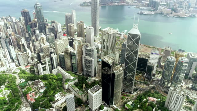 the top view of the building tower in green hong kong city - центральный район стоковые видео и кадры b-roll