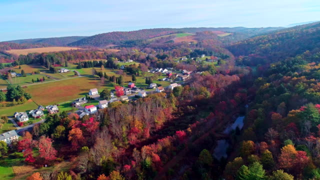The top view on the road in the small town Kunckletown, Poconos, Pennsylvania, with fall foliage. Aerial drone video.