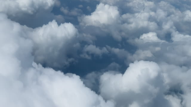 The Tops of Clouds while Flying through Them (View from Aircraft)