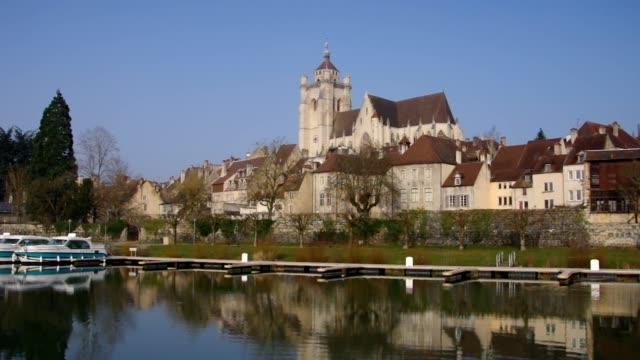 the town dole and church in france - formaggio comté video stock e b–roll