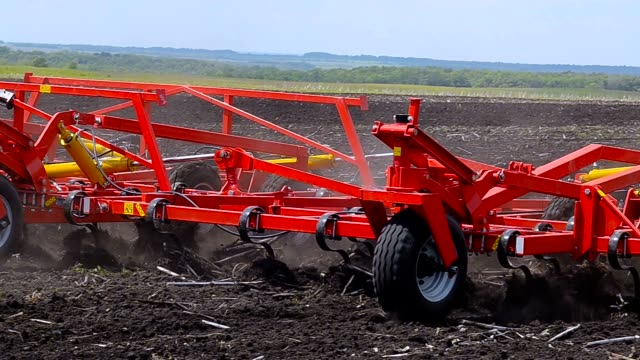 The tractor processes the soil. The tractor processes the soil. Cultivator harrow agricultural equipment stock videos & royalty-free footage