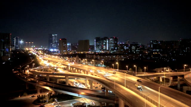 The traffic interchange at night in city video
