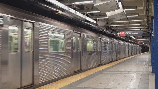 the train departed from canal street subway station in new york city deserted because of covid-19 coronavirus outbreak. - space video stock e b–roll