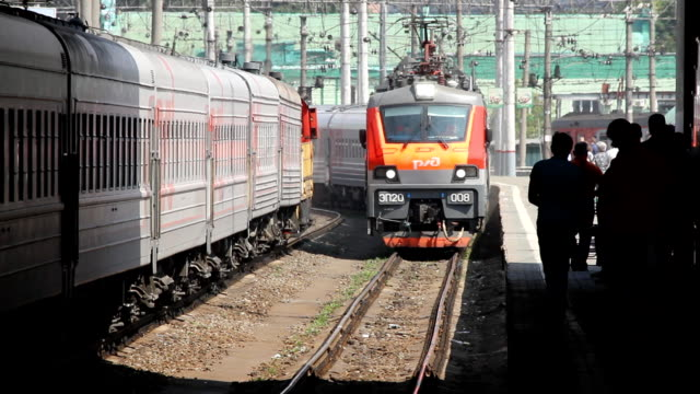 The train leaving the platform / Russia. Moscow Kazansky Railways Station in Moscow railroad station platform stock videos & royalty-free footage
