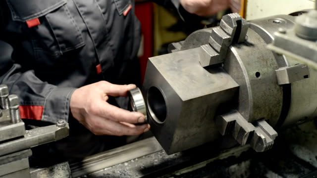 The turner makes a test installation of the bearing in the hole The turner makes a test installation of the bearing in the hole. Boring the inner hole. endurance stock videos & royalty-free footage