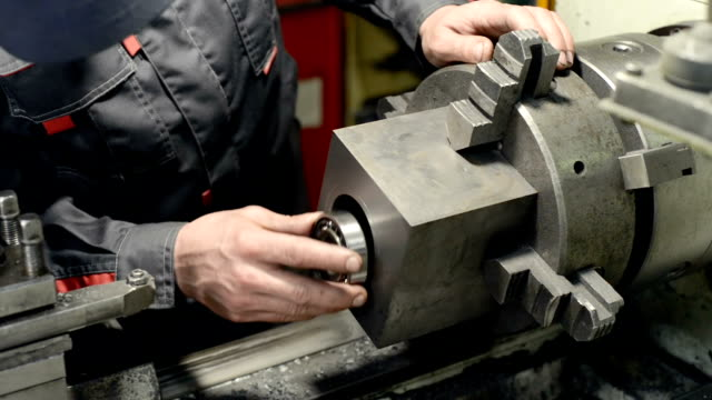 The turner measures the part by means of a caliper, then makes a test installation of the bearing in the hole. video