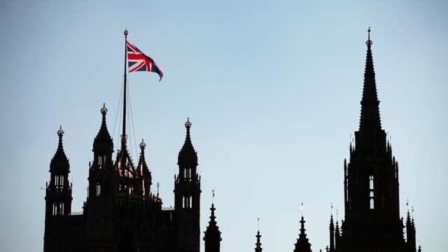 The United Kingdom Flag Over The Palace Of Westminster