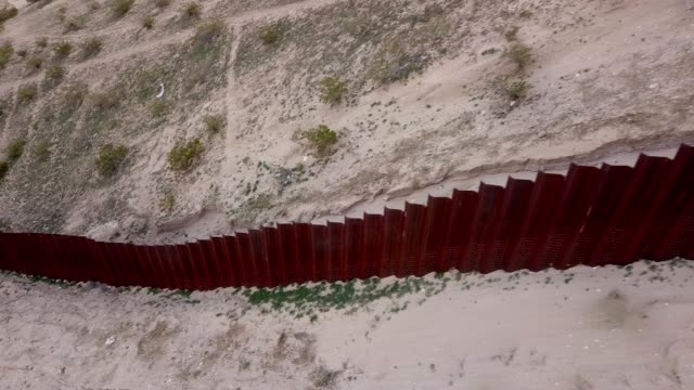 the united states mexico international border wall between sunland park new mexico and puerto anapra, chihuahua mexico - wall video stock e b–roll