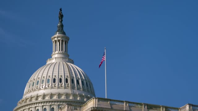 The US Capitol Building Dome Blue Sky with Flag and Freedom 20180413