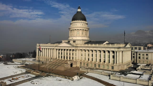 the utah state capitol building in salt lake city on a hazy winter morning - neoclassical architecture stock videos & royalty-free footage