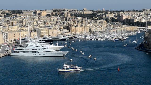 The vertical panning of view on Birgu and  yacht marina, Birgu, Malta video