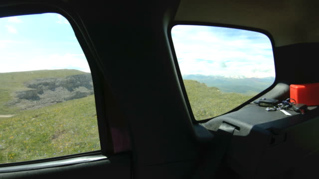The view from the car on the natural landscape of the plateau is high in the mountains on a sunny day. Road trip through the North Caucasus The view from the car on the natural landscape of the plateau is high in the mountains on a sunny day. Road trip through the North Caucasus. rv interior stock videos & royalty-free footage